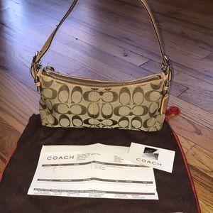 Coach signature shoulder purse with receipt